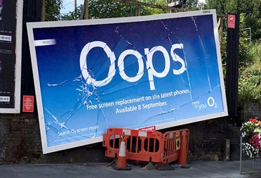 'Cracked' billboards promote free screen replacement