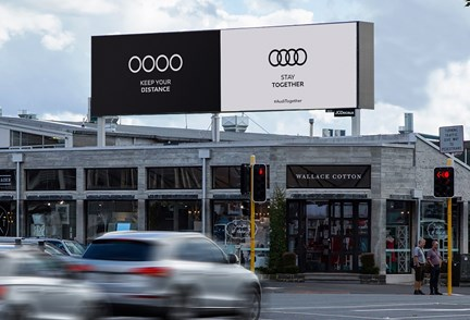 Audi promotes public safety by socially distancing its own logo in a clever, contextually relevant way.